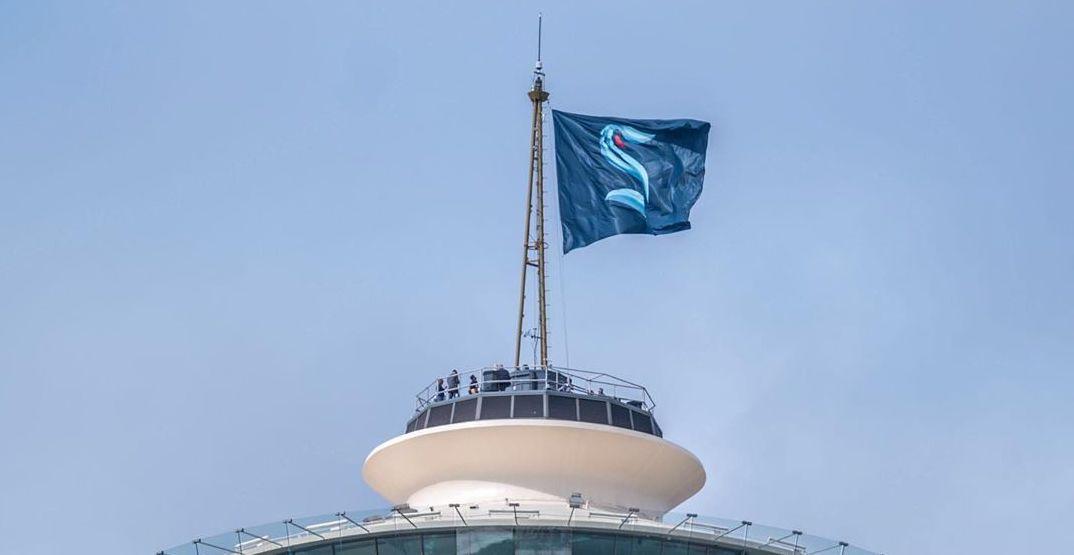 Seattle Kraken flag flies atop of the Space Needle this