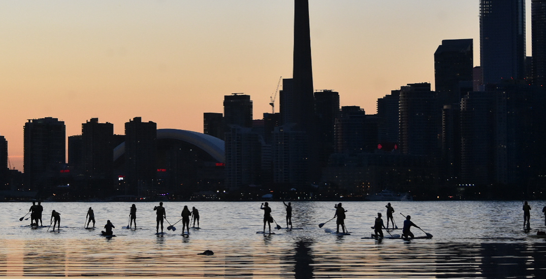 You can go on a sunset paddle boarding adventure in Toronto this summer
