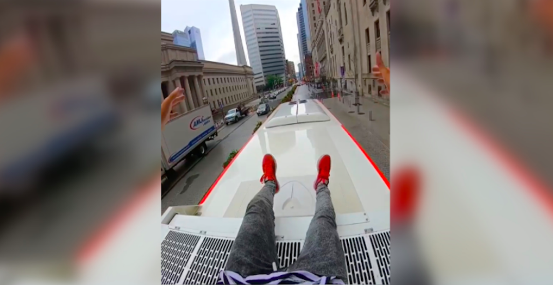 TTC investigating video of man climbing to the top of a bus in Toronto