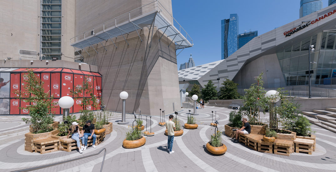 A mini park covered in flowers, trees has popped-up outside the CN Tower