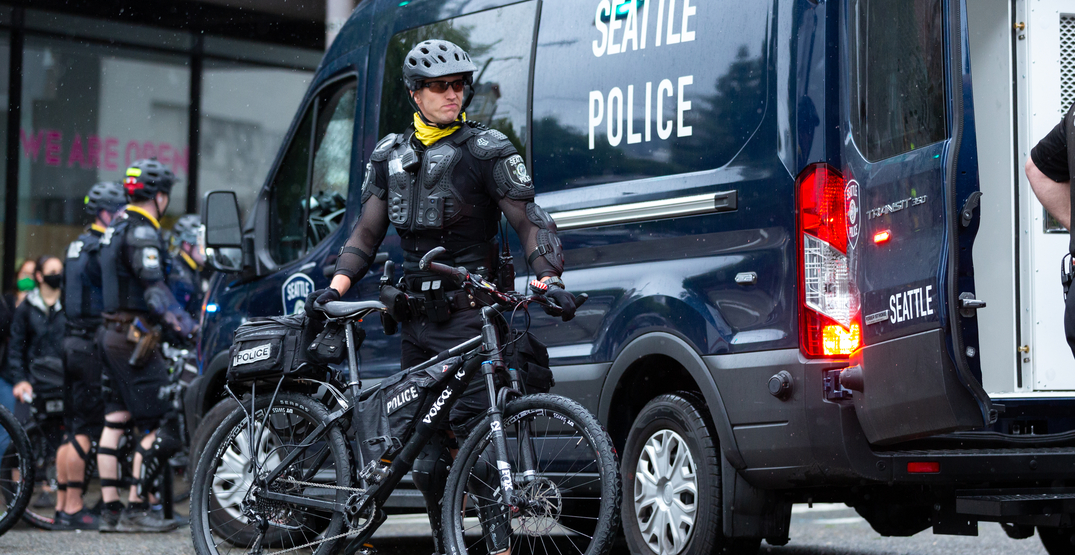 Seattle Police officer seen riding bicycle over a protester's head (VIDEO)