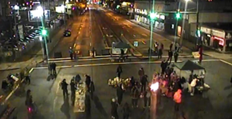 Demonstrators in Vancouver block traffic at Hastings and Clark