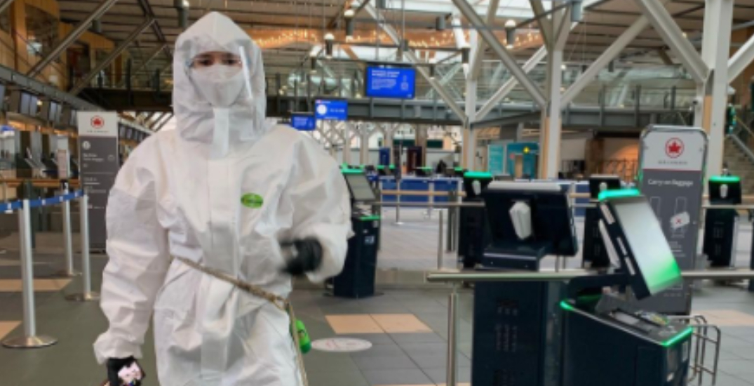 Nina Dobrev spotted wearing a hazmat suit at YVR (PHOTOS)