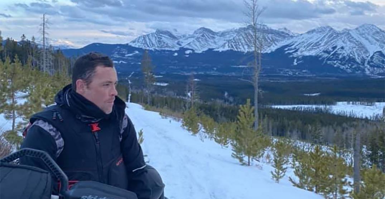 Andrew Harnett snowmobiling