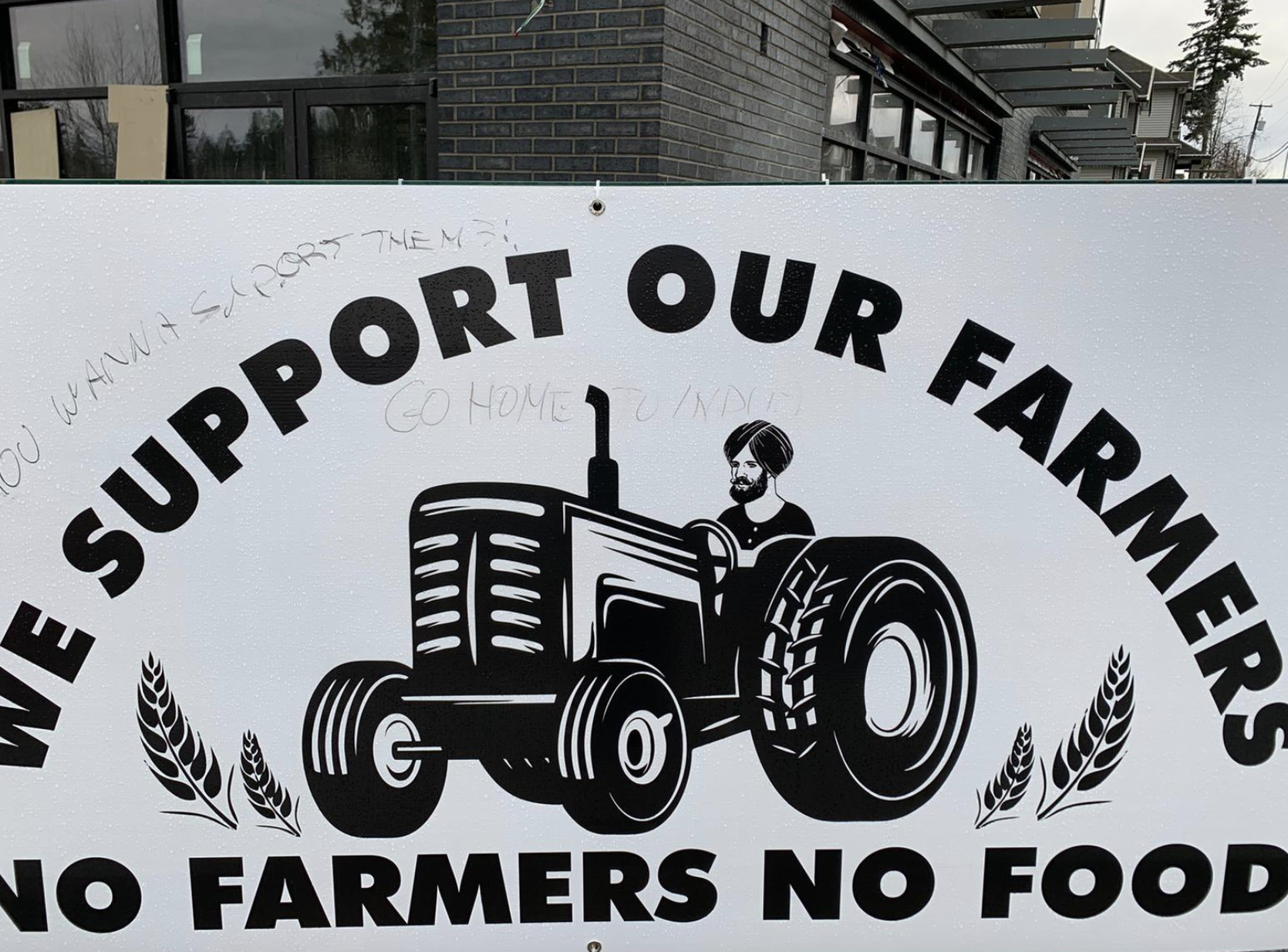 racist sign farmers protest