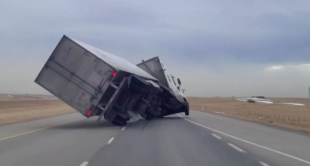 Extreme winds topple transport truck on Alberta highway (VIDEO)