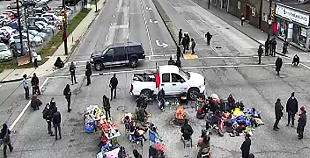 Indigenous youth demonstrators block traffic near Vancouver port for solidarity protest