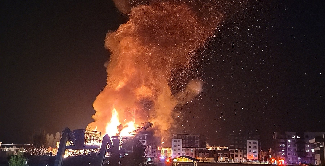 Massive structure fire tears through condo buildings in Langley