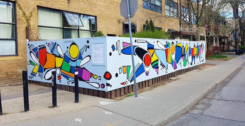 Toronto artist paints rainbow-inspired mural to shine light in dark times