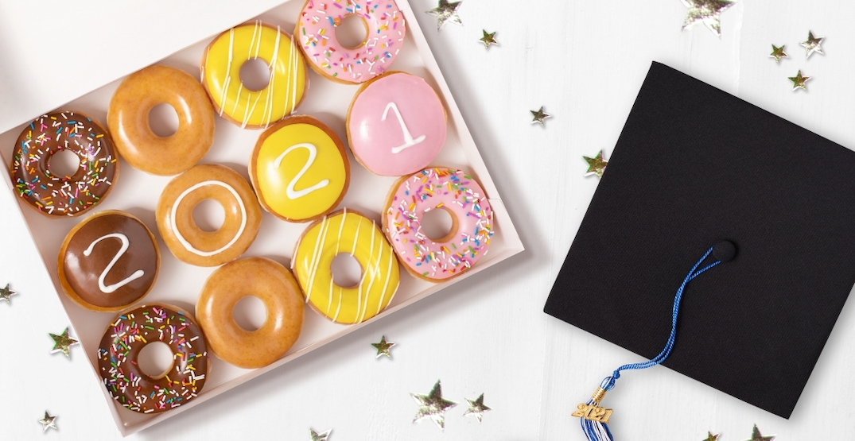 Krispy Kreme is offering graduates a dozen doughnuts for FREE