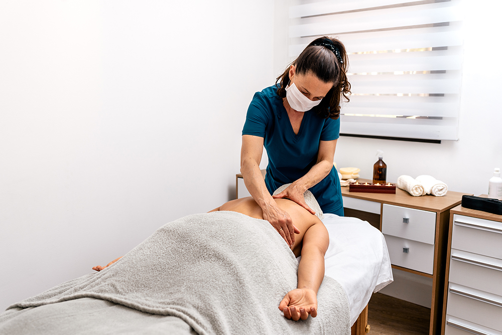 Female RMT giving a back massage