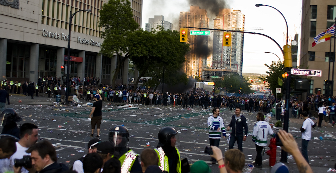 Filmmakers setting up 2011 Canucks riot display outside Vancouver Art Gallery