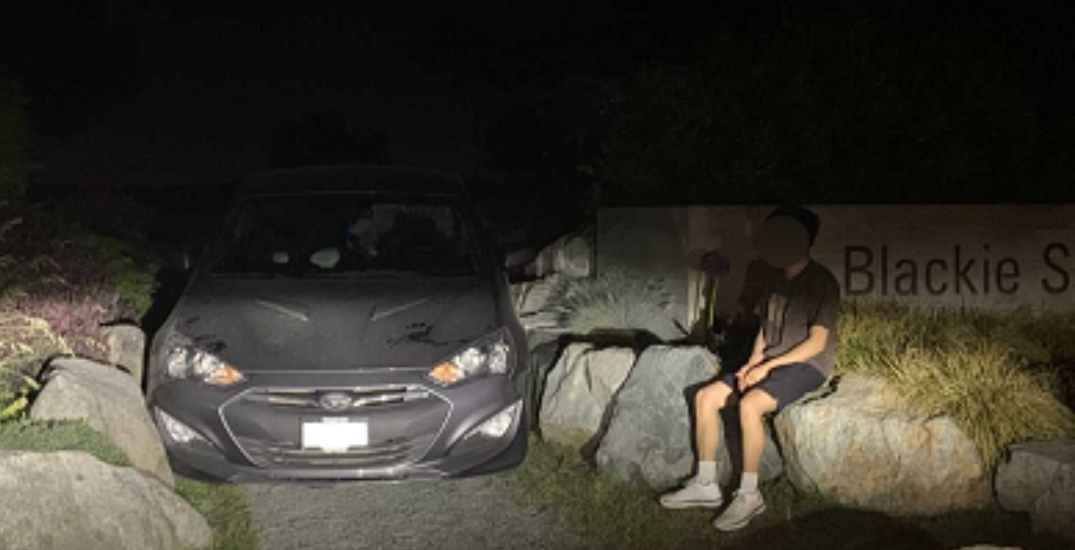 A rock and a hard place: beachgoer gets car stuck between boulders at Blackie Spit