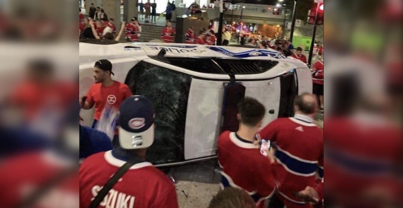 Canadiens fans destroy cop car as Montreal police in riot gear move in (VIDEOS)