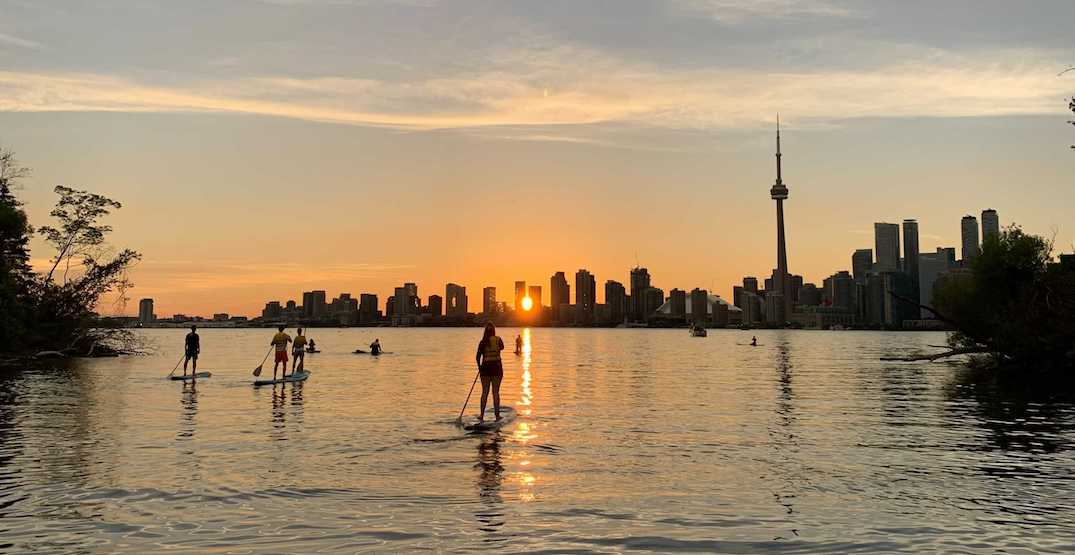 You can go on a sunset paddleboarding adventure in Toronto this summer