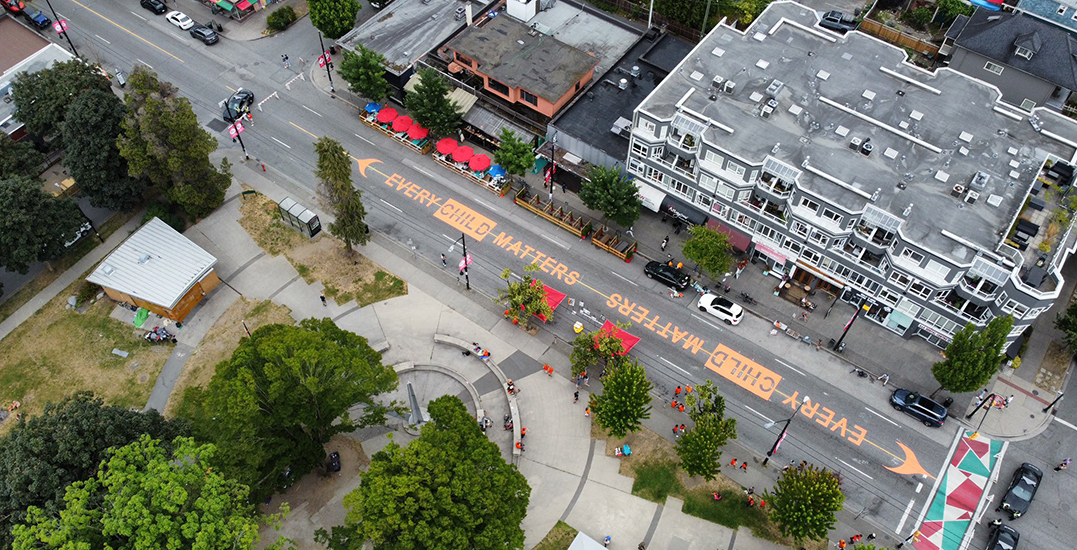 """Massive """"Every Child Matters"""" street mural painted on Commercial Drive"""