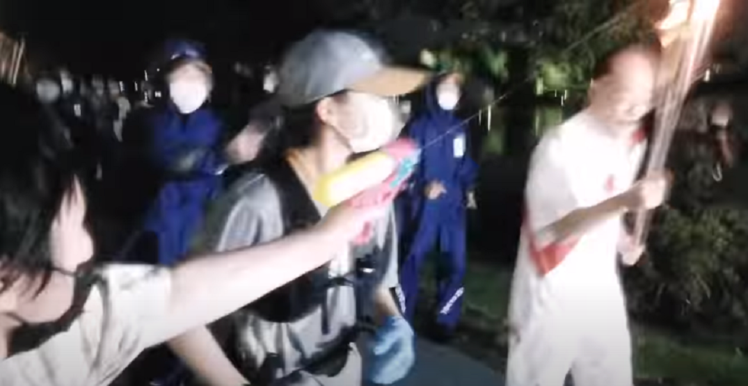 Protestor arrested for trying to extinguish Olympic torch with water gun (VIDEO)