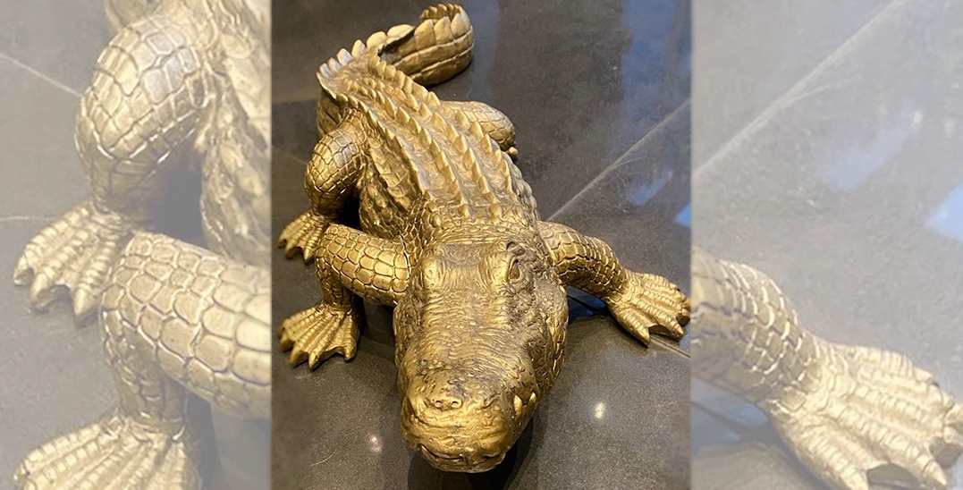 """Police respond to hysterical condo dweller who saw """"realistic"""" fake alligator"""