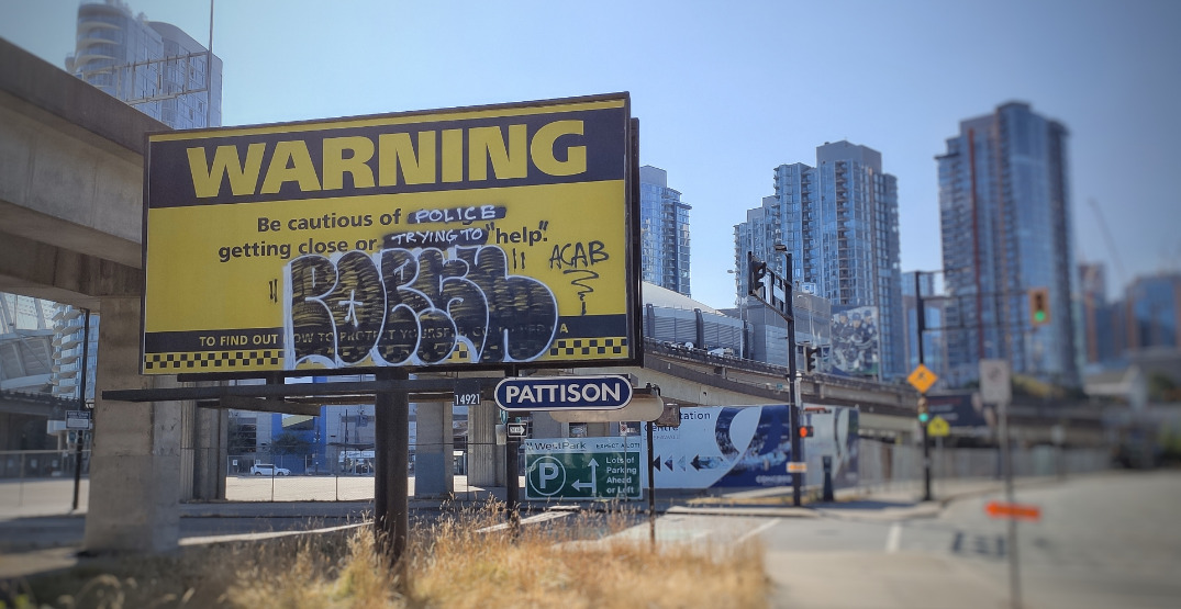 Vancouver Police billboard urging caution gets vandalized with graffiti