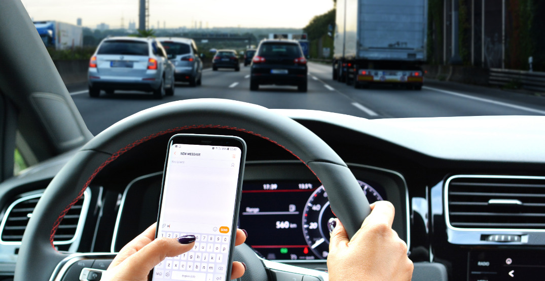 """Man gets distracted driving ticket for """"holding"""" phone between leg and seat"""