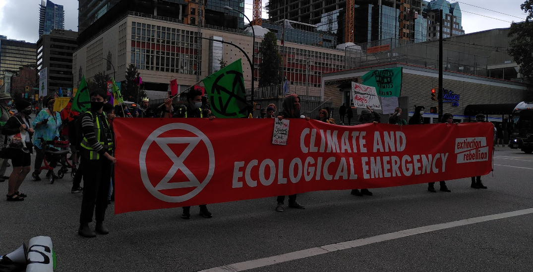 Four arrested after climate protestors block downtown Vancouver intersection