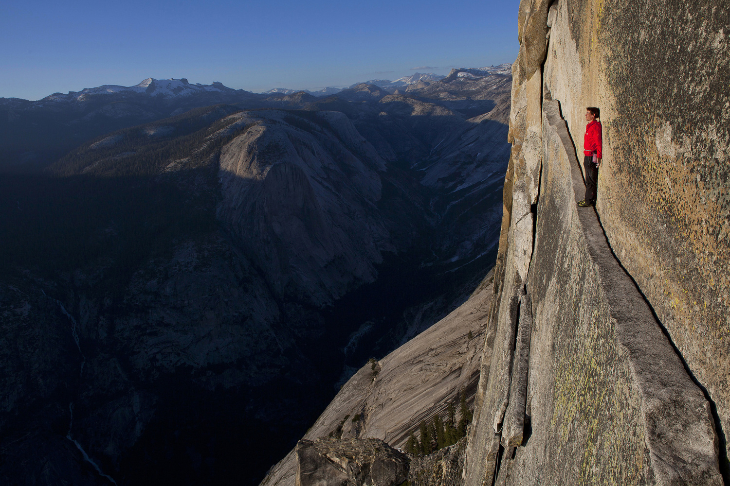 Image: Alex Honnold reenacting his rope-less free climb of the 2,500 ft. Northwest Face of Half Dome (5.12), Yosemite National Park, California, USA.  Alex's ascent is arguably the hardest free solo done to date in Yosemite.