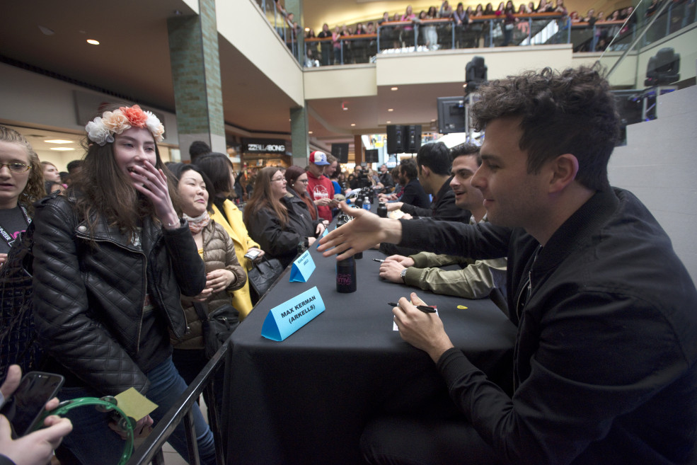 2015 JUNO Fan Fare. A fan is very excited to meet the Arkells. Lime Ridge Mall, Hamilton, On. March 14, 2015. Photo: CARASiPhoto.