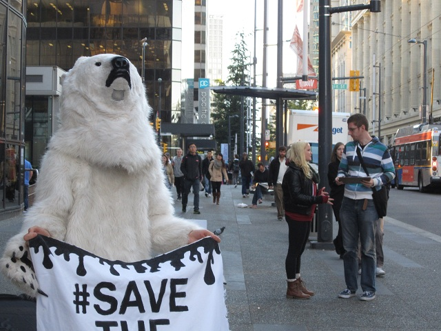 polarbeartakesactionforthearcticindowntownvancouver2