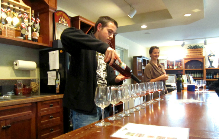 Resident Wine Maker Toby Bowman pouring samples.