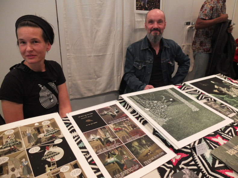 oronto artists Pat Shewchuk and Marek Colek, who work under the name Tin Can Forest, with some of their prints on display at the Vancouver Art/Book Fair yesterday. Their work is inspired by Canadian forests and Slavic folklore.