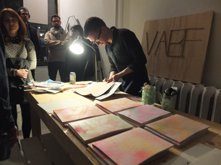 Members of the public were invited to bring loose pages of writing or illustrations to the Vancouver Art/Book Fair opening event on Friday. The pages were bound together and displayed at the fair as part of a collaborative book making project.