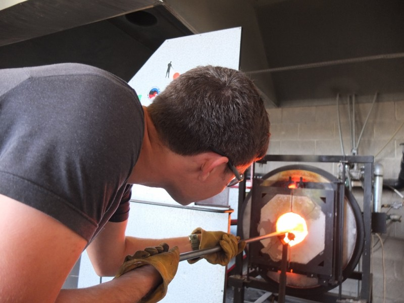Taking a glass-blowing workshop is a hands-on experience.