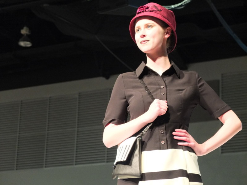 This model in the Circle Craft Christmas market fashion show wears a Rosehip Studio hat, dress by Annie 50 and bag from Lina Cutnam.
