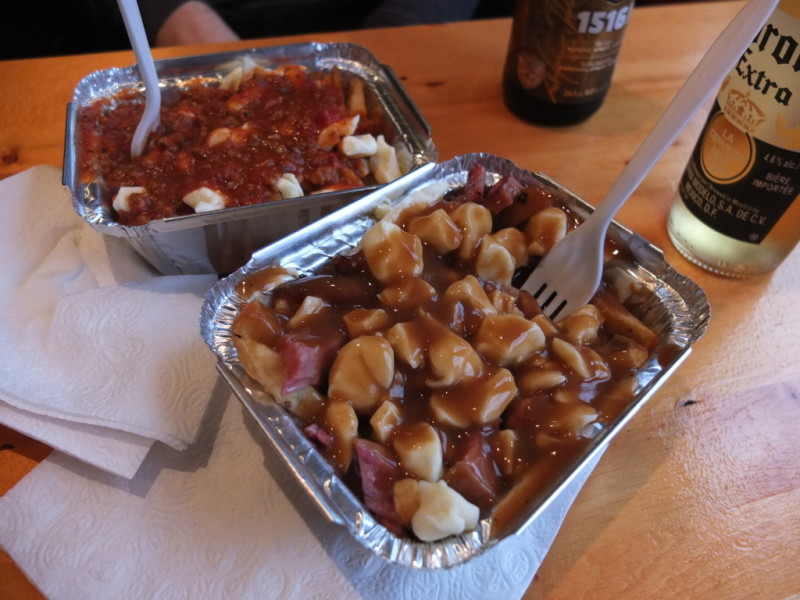 Montreal smoked meat (front) and Italian poutine at La Belle Patate on Davie Street.