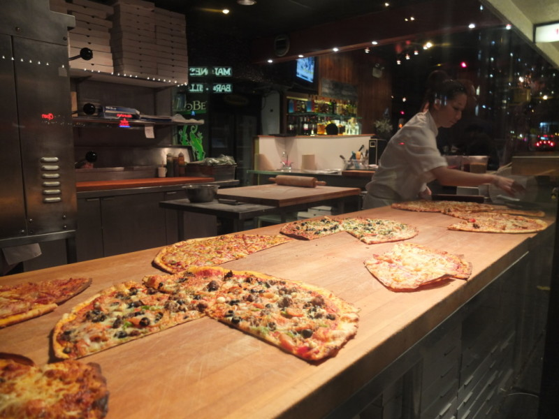 Window shop for pizza by the slice at Goldies.