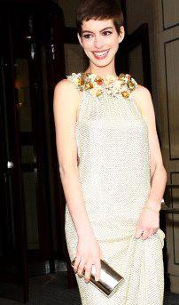 Anne Hathaway at the Batman premiere with Jill Milan's 450 Sutter bag