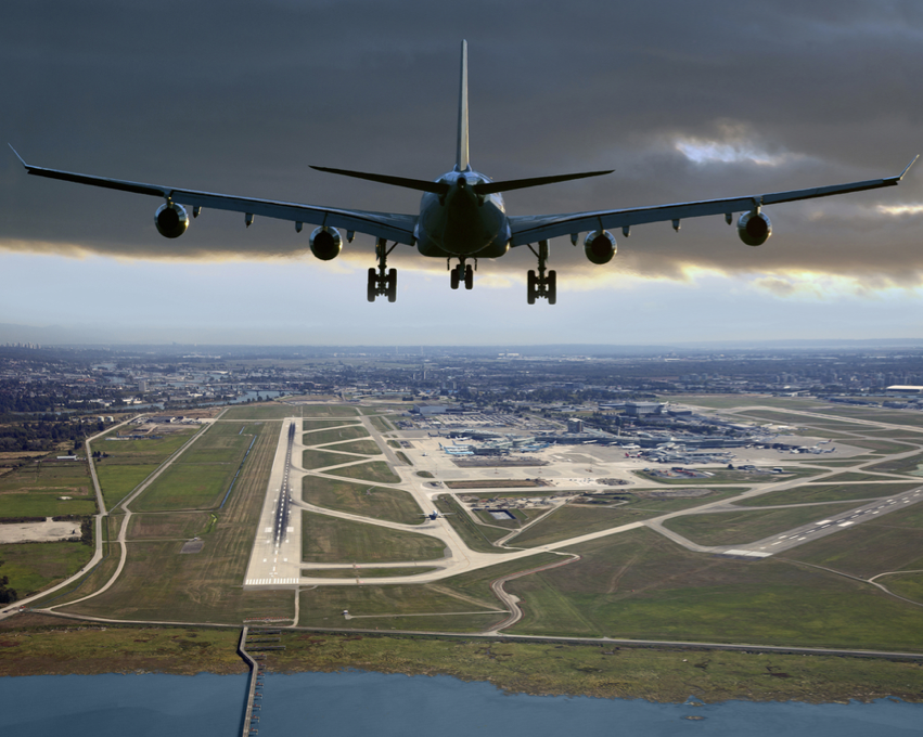 YVR plane landing Vancouver International Airport / Shutterstock