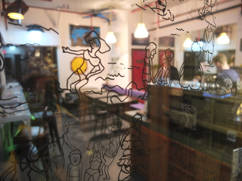 A portion of Kie Kambara's detailed drawing on the glass door at Tiger's Drink House.