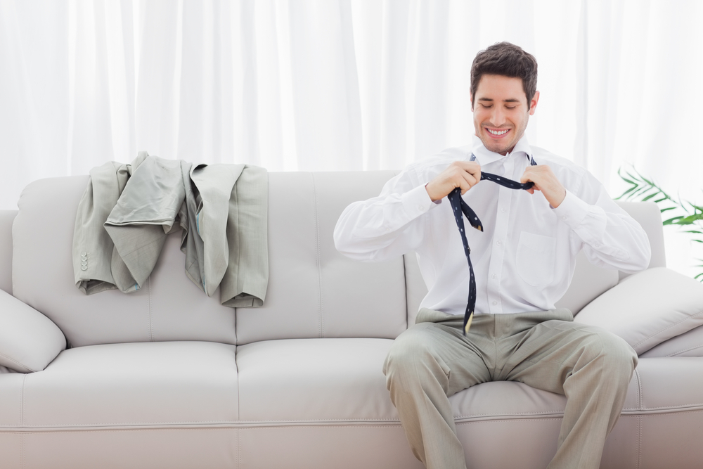 Businessman loosing tie / Shutterstock