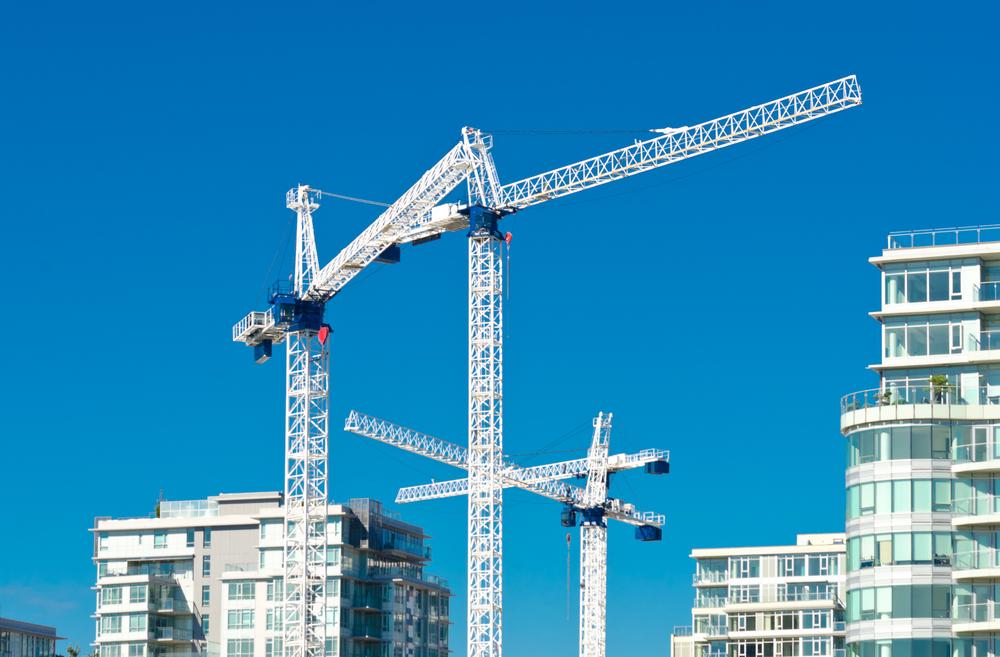 Condo construction cranes economy / Shutterstock