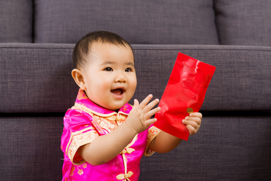 Chinese New Year red pocket lucky money / Shutterstock