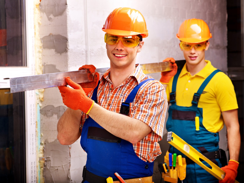 Builder uniform indoor construction workers / Shutterstock