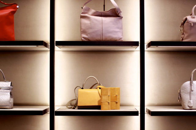A wall of handbags line a wall at the new Max Mara flagship boutique. Photo by Viranlly Liemena.