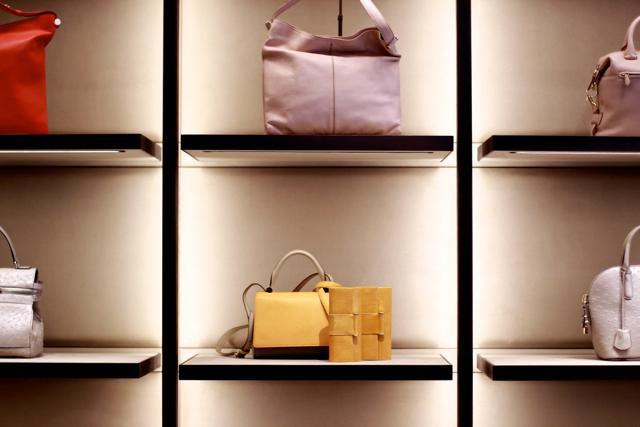 A wall of handbags line a wall at the new Max Mara flagship boutique. Photo by Viranlly Liemena.
