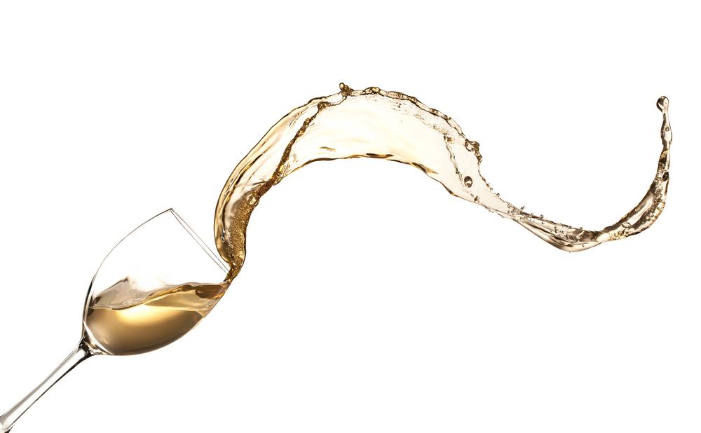 White wine splashing out of glass