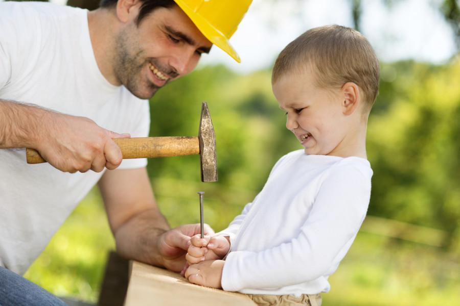 Child father work construction hammer / Shutterstock