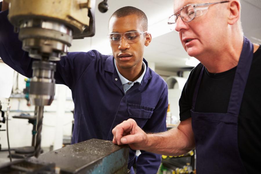 Engineer Teaching Apprentice Workers / Shutterstock