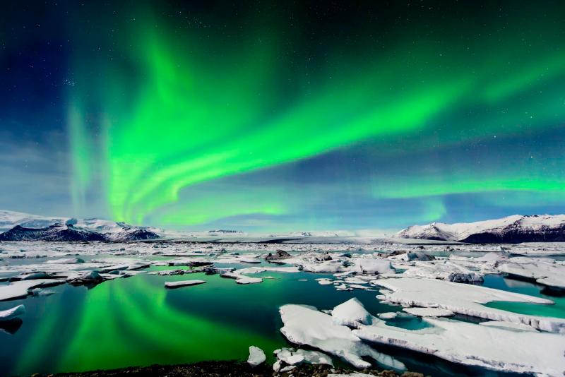 An aurora seen over the Grundarfjordur Harbor in Iceland. Photograph by Larry Gerbrandt / Barcroft USA