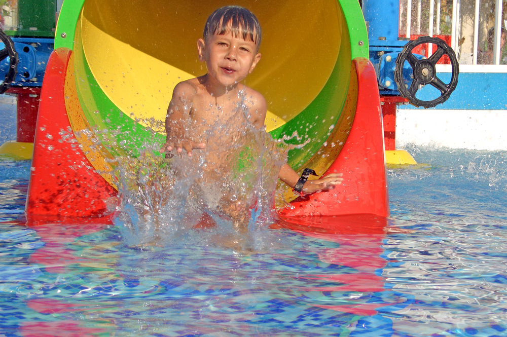 Young boy falls into the water