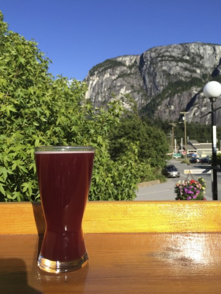 Enjoying a pint at Howe Sound Brew Pub, with The Chief in the background